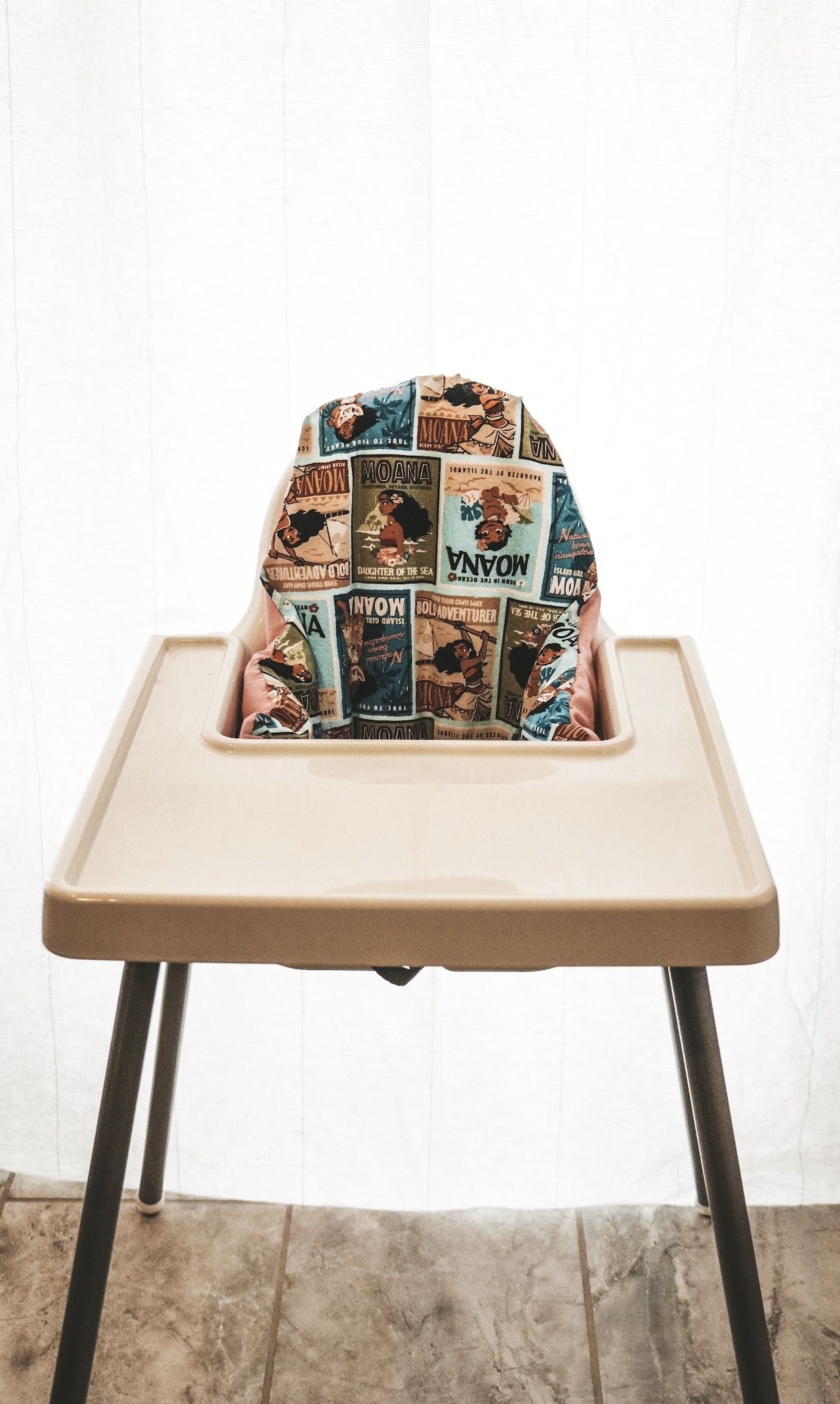 DIY IKEA highchair cover. Disney fabric that covers the
