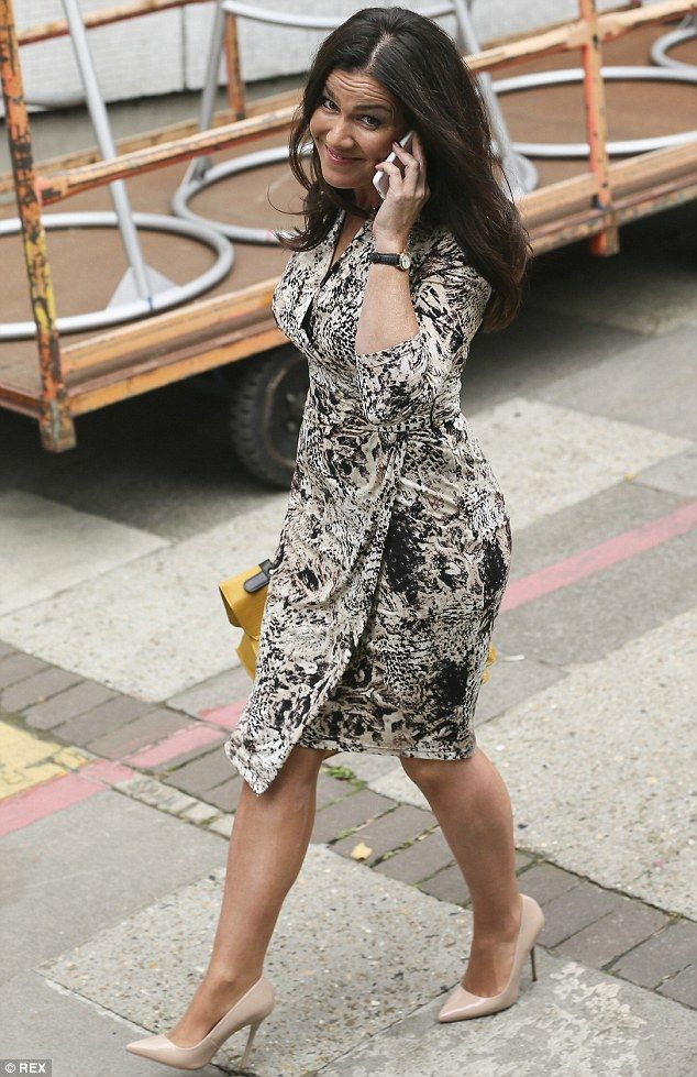 Hi there! Susanna, who was seen smiling at photographers while chatting on her phone, inje...