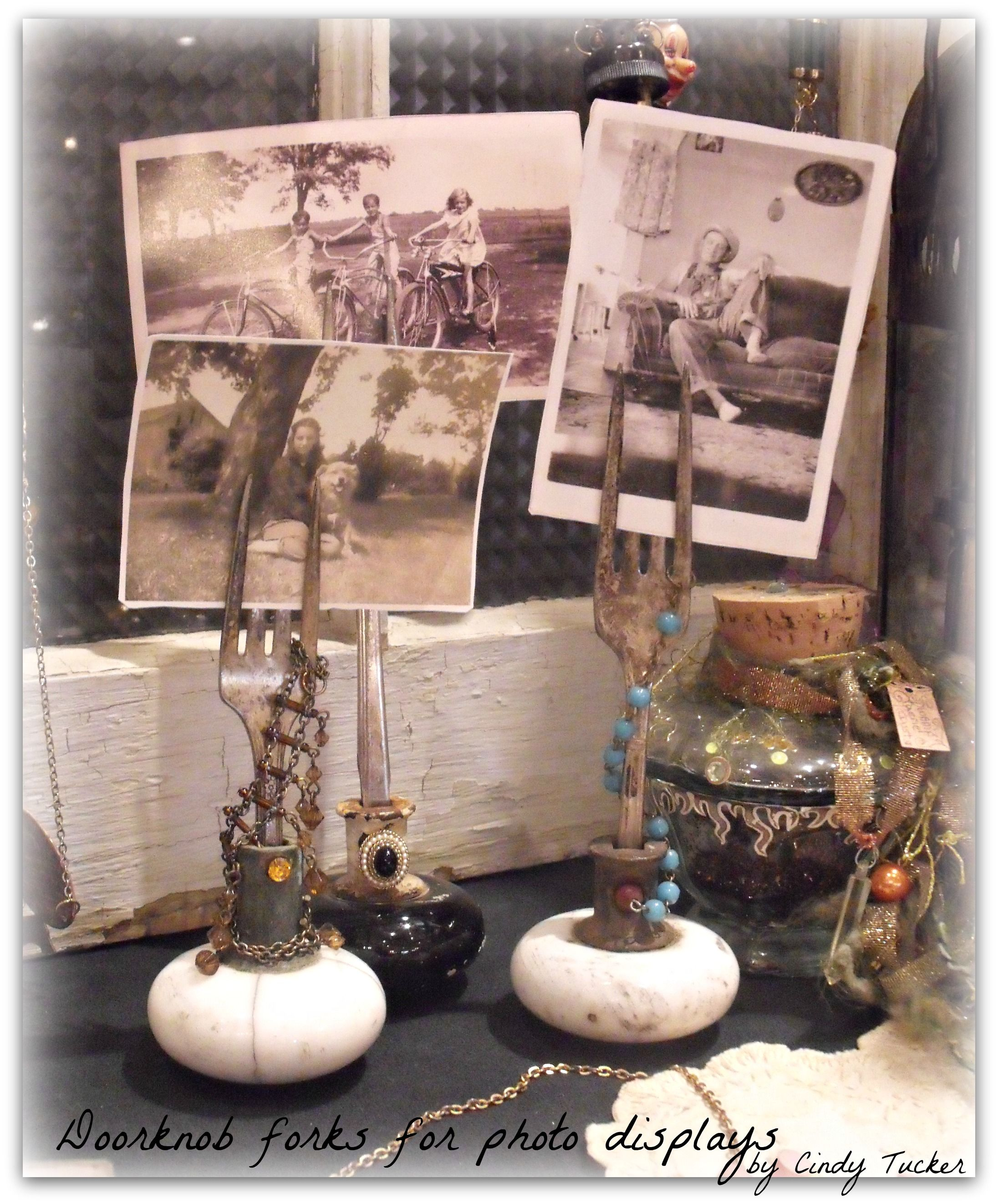 these photo or business card holders are made from vintage doorknobs and silver plated forks