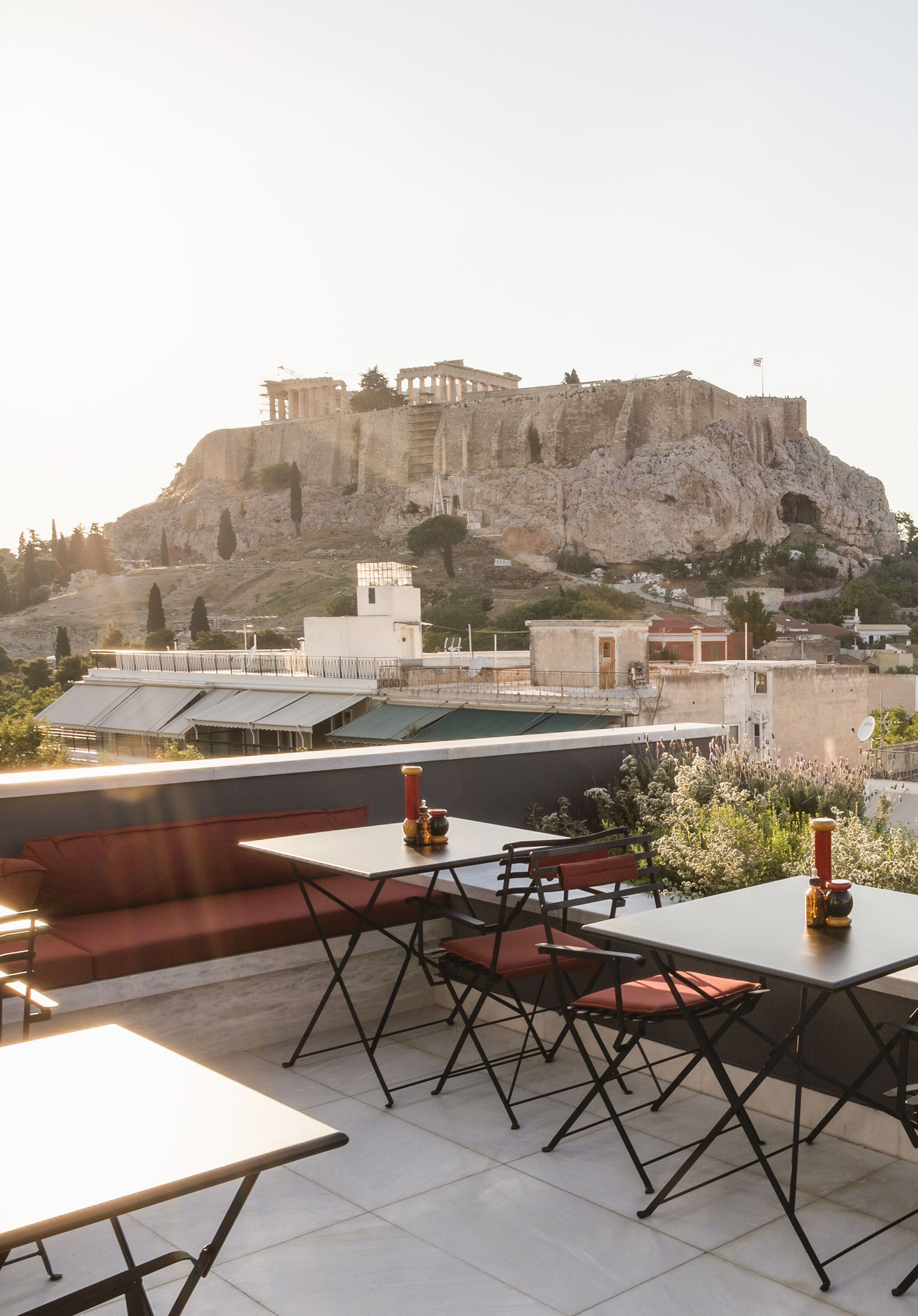 Athenswas plaka athens greece book through i escape com an upscale design hotel with playful retro stylings whose rooftop bar has incredible views