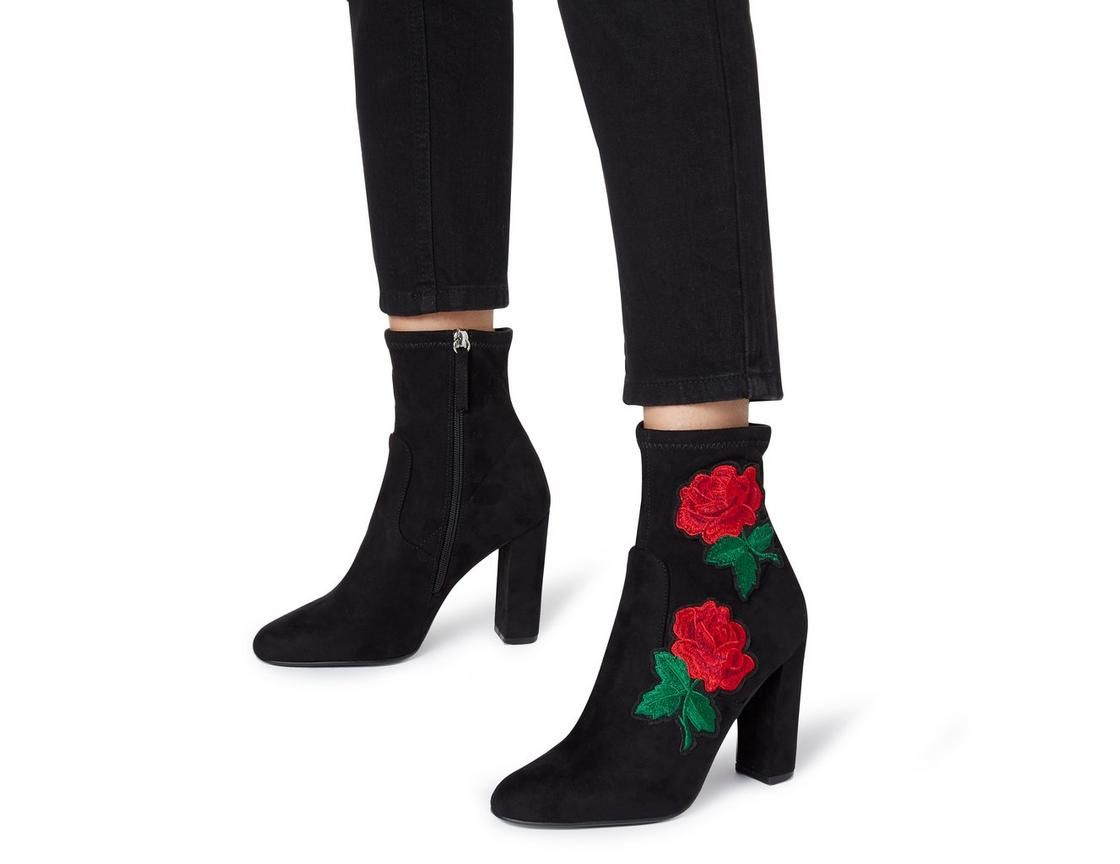b7f3ed60077 This Steve Madden Edition SM ankle boot is a pretty everyday style.  Featuring a floral applique design