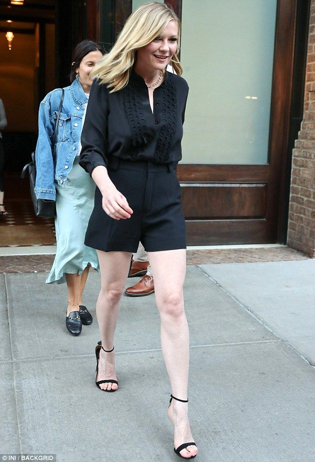 264635f27204 Stemming the tide  Kirsten Dunst showcased her sensational legs in a skimpy  pair of shorts in New York on Thursday