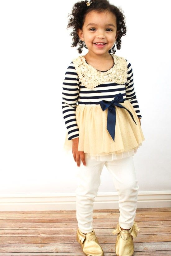 """'BON VOYAGE' DRESS  - -Sequin collar with navy and cream striped bodice.  -Skirt fits shorter like a tutu. It can be worn alone or with tights or leggings.  -This dress has """"grow with me"""" technology so that it can go from a dress to a shirt dress as your child grows. Sleeves tend to run a little long when  worn as a dress (for smaller sizes) but can be rolled, scrunched or shortened."""