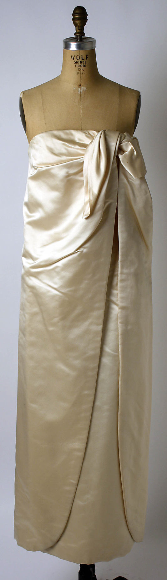 Ivory silk satin strapless evening gown, by George Peter Stavropoulos, American, ca. 1960.