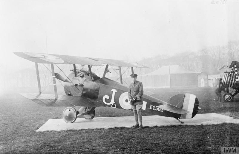 Roy Foss of No  28 Squadron RAF by his Sopwith Camel biplane
