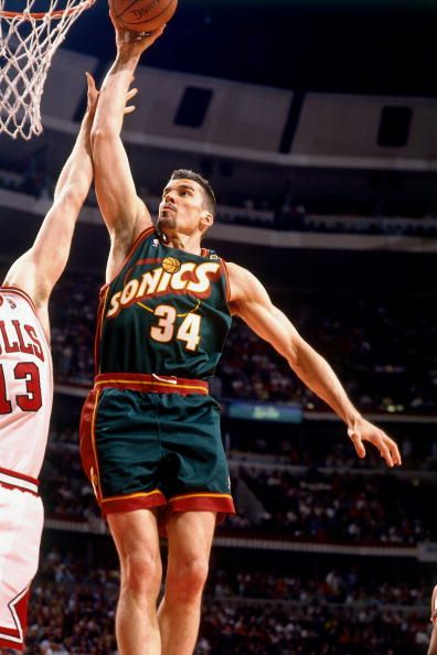 Frank Brickowski of the Seattle SuperSonics dunks against Luc Longley of  the Chicago Bulls during Game Six of the 1996 NBA Finals at the United. 7a19a69db