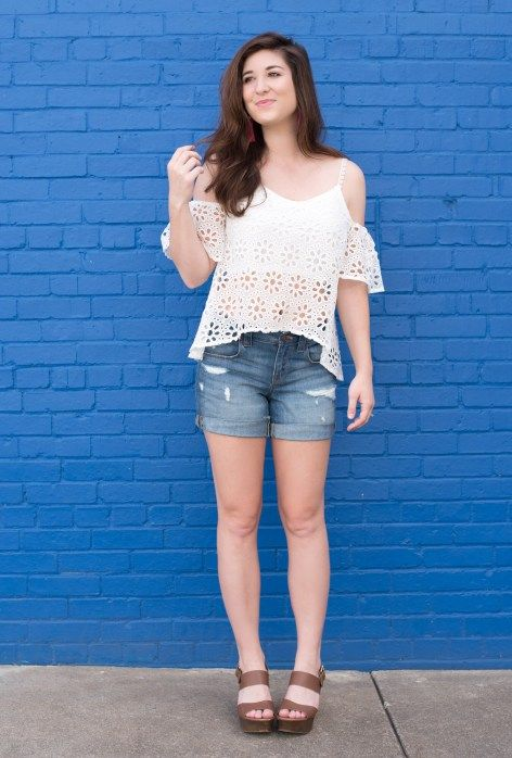 Adorable cold shoulder white top with floral cut outs. Worn with distressed denim shorts and a chunky brown heel. Perfect for a casual summer look. From I Do Declare Blog