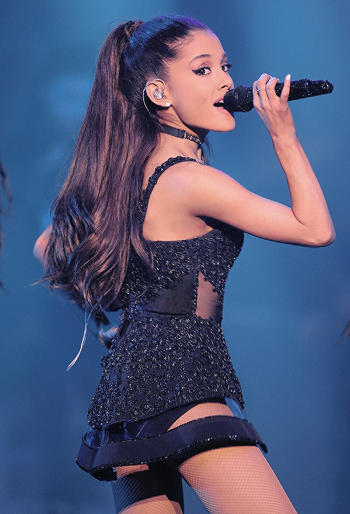Ariana Grande-singing on stage wearing a pretty cute mini black outfit.:).
