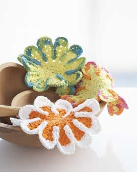 Bright and sunny floral-inspired dishcloths bring life to your kitchen. Shown in Lily Sugar'n Cream.