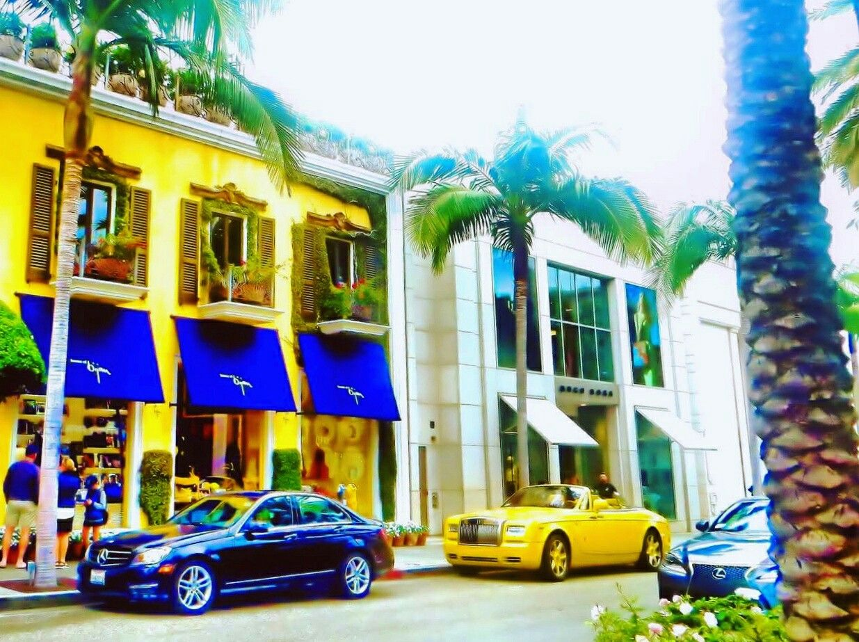 Where High Fashion and Lux Cars Meet. House of Bijan, Designer for Men. Mercedes Benz, Rolls Royce, Lexus. In one Snapshot. Rodeo Drive, Beverly Hills, California.