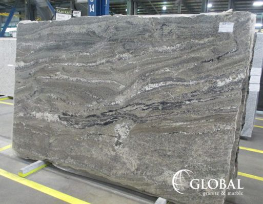 Sucuri Granite. A Dark Tan, Brown, And Taupe Background With Occasional  Burnt Orange And Black Veining.