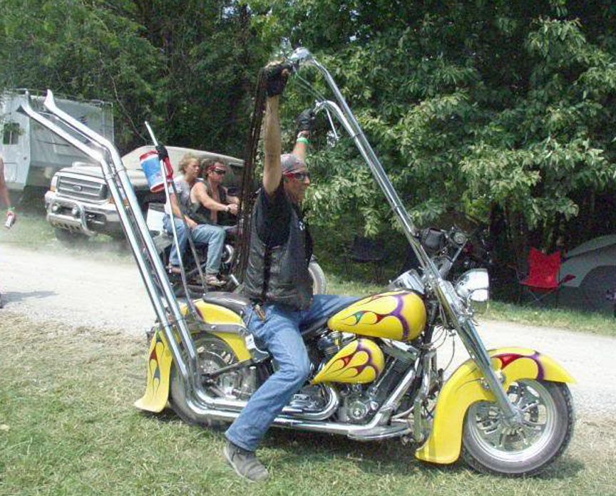 Yellow Motorcycle With Really High Paperhangers And Exhaust And