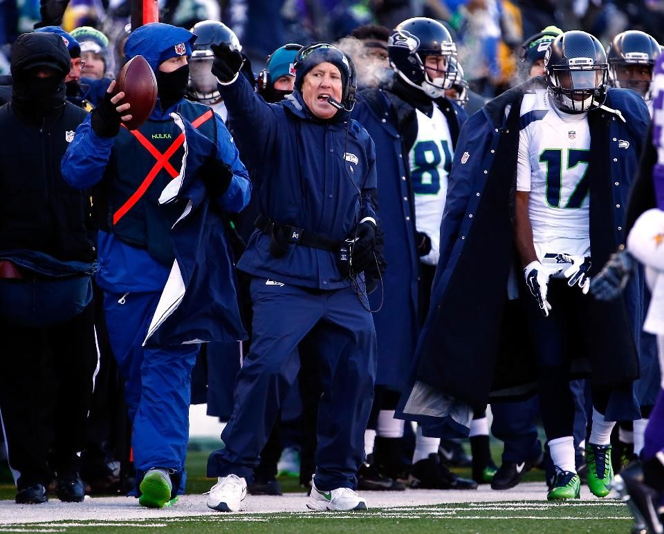 Head coach Pete Carroll of the Seattle Seahawks motions for a first down on the sidelines during the NFC wild card playoff game against the Minnesota Vikings at TCFBank Stadium on January 10, 2016 in Minneapolis, Minnesota.