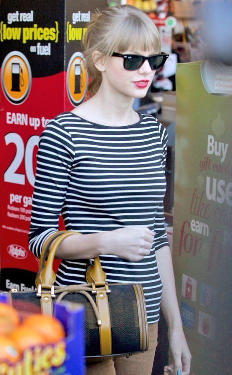 We've seen Taylor Swift rock these wayfarers before! But we love how they look with her straight-across bangs and ponytail! They pair nicely with her preppy striped top too!