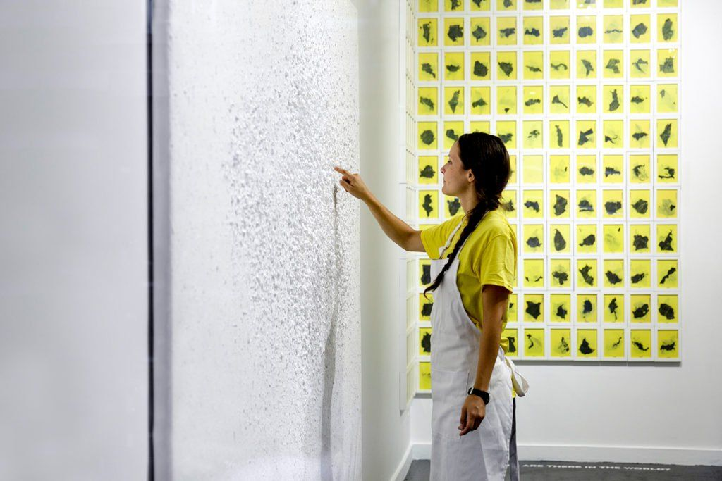 Capucine Gros adding to her work Human Strokes (2010–) at Catinca Tabacaru Gallery. Courtesy of Catinca Tabacaru Gallery.
