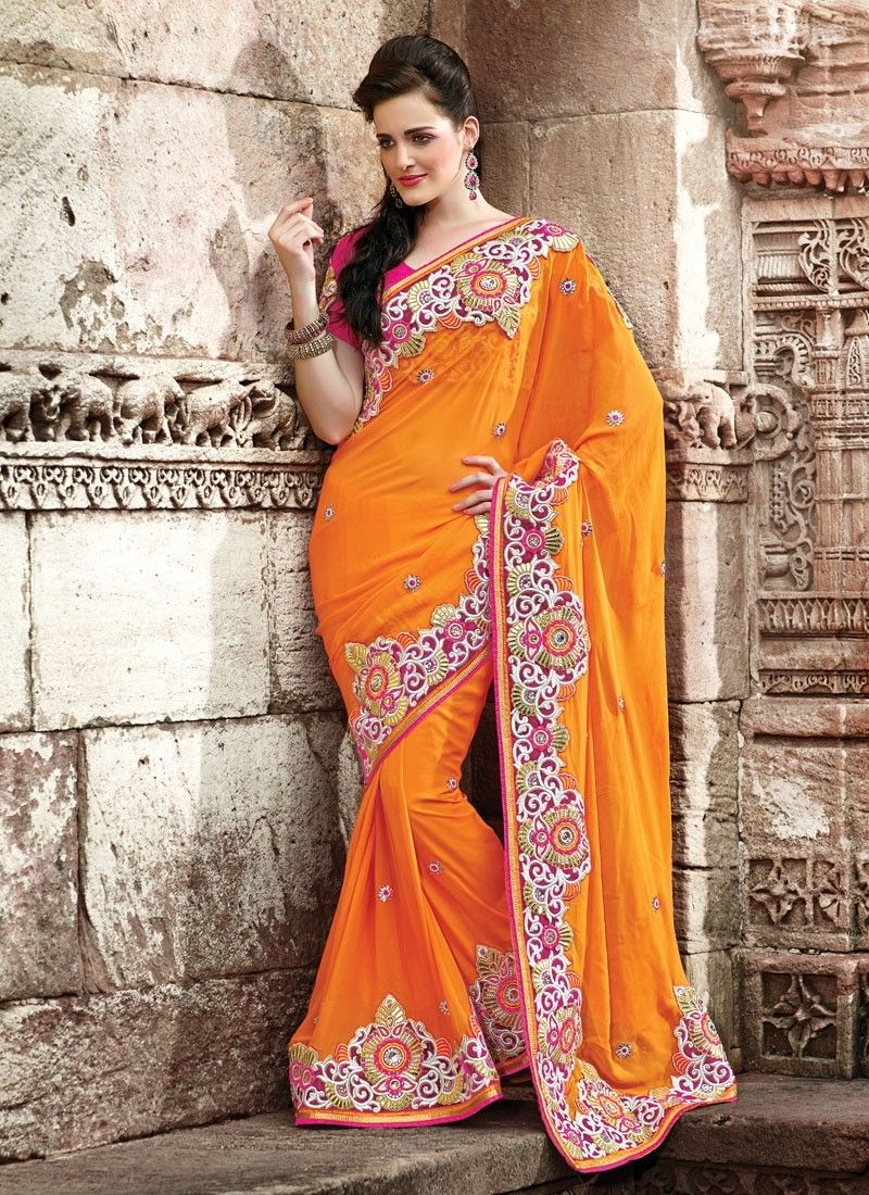 Classy embroidery style orange color georgette partywear saree also rh in pinterest
