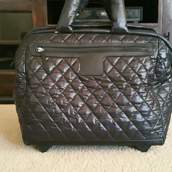 043ffbaba9ea Chanel Black Quilted Nylon Rolling Bag Has 2 small tears. One by handle and  one on bottom