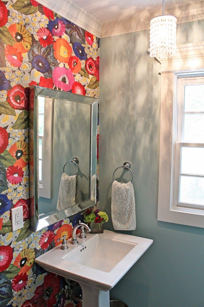 large floral wallpaper on one wall enlivens a powder room on the rh pinterest com
