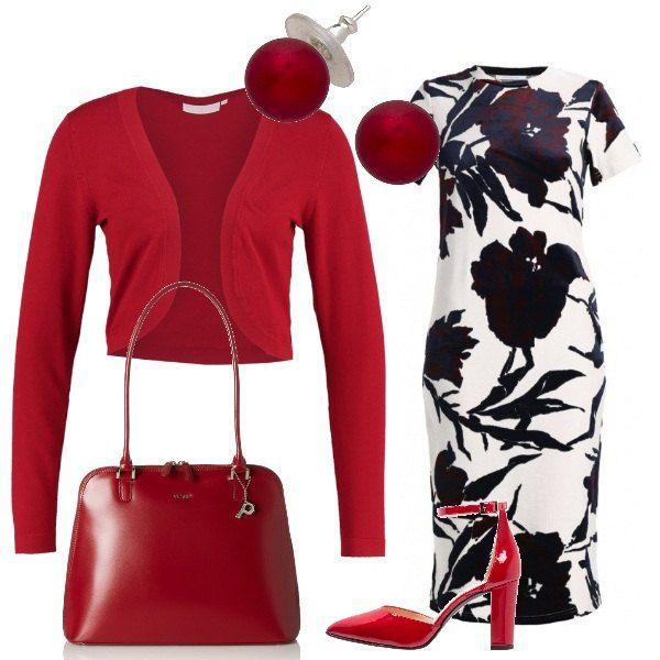 new product c11c2 5726e Un vestito a tubino bianco con fiori neri viene abbinato ad ...