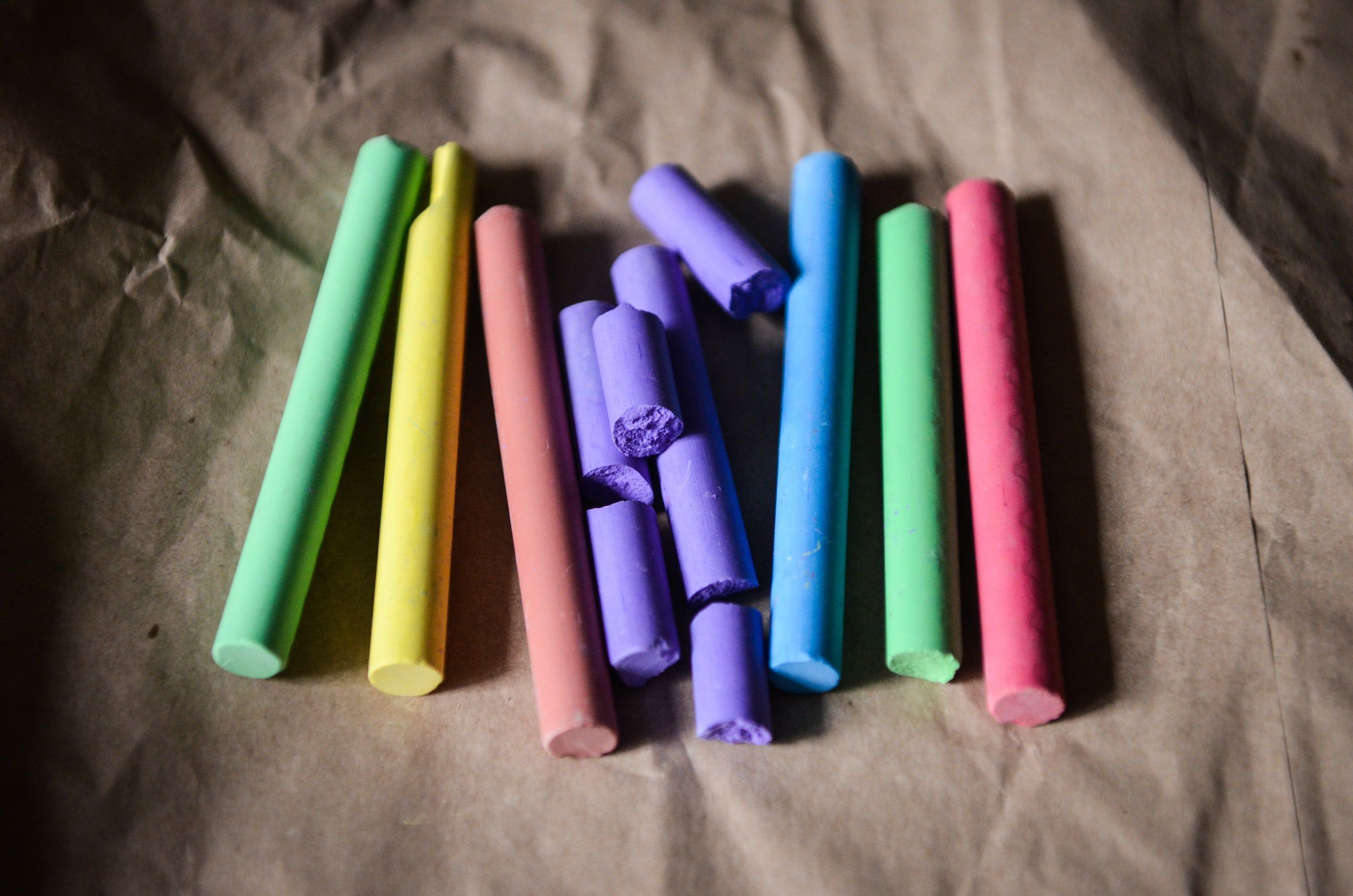 Close Up Of Chalk Crayons Arranged In Rainbow Colours On