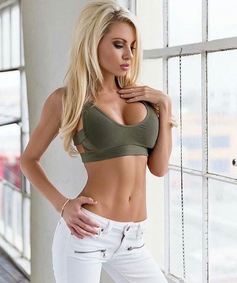 Beautiful blonde gorgeous sexy woman milk stock photo