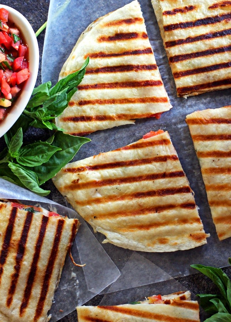 Caprese Quesadilla — This caprese quesadilla stuffed with mozzarella, tomatoes, and basil is the perfect way to spice up a Mexican favorite | bitsofumami.com