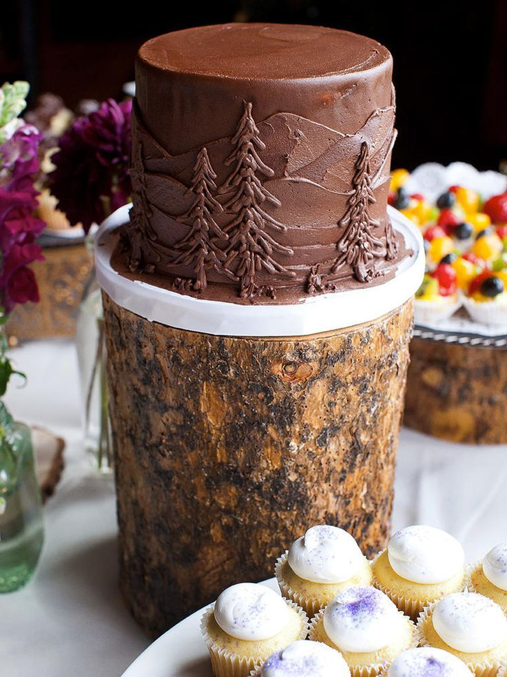 A Cake With Evergreen Details On Tree Stump Stand Will Bring Touch Of