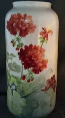 painting of red geraniums on a porcelain vase by porcelain artist and china painting teacher, Jane Wright.
