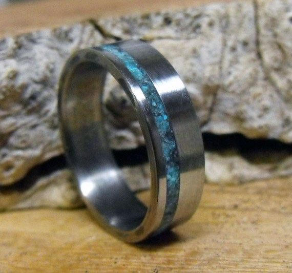 Hey, I found this really awesome Etsy listing at https://www.etsy.com/listing/62236648/titanium-ring-with-turquoise-inlay