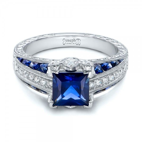 102163 This beautiful engagement ring features a blue sapphire