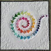 Spiral Geese Mini Quilt - via @Craftsy  #quilt #quilting #longarm #machinequilting #tinlizzie18