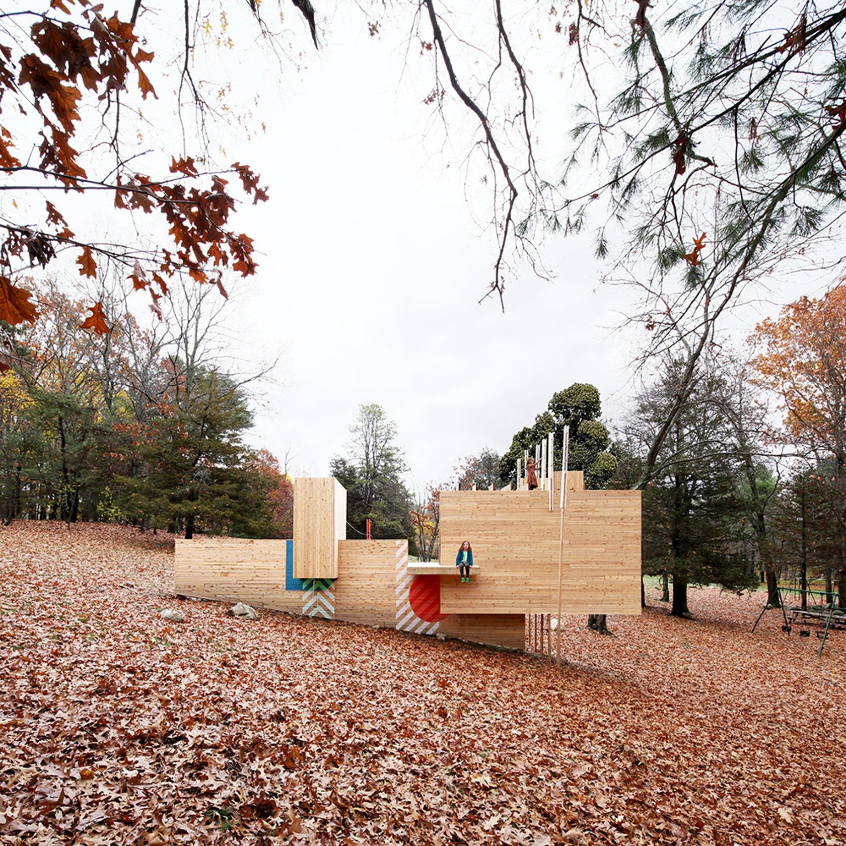 this play structure is situated on the sloping landscape of a mid