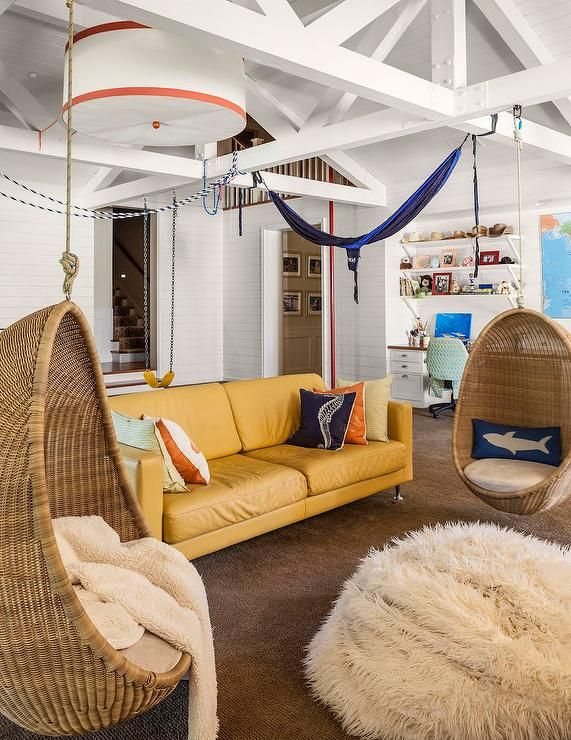 Beachside Living Room With White Truss Ceiling Hanging Rattan Pod Chairs And Mustard Yellow