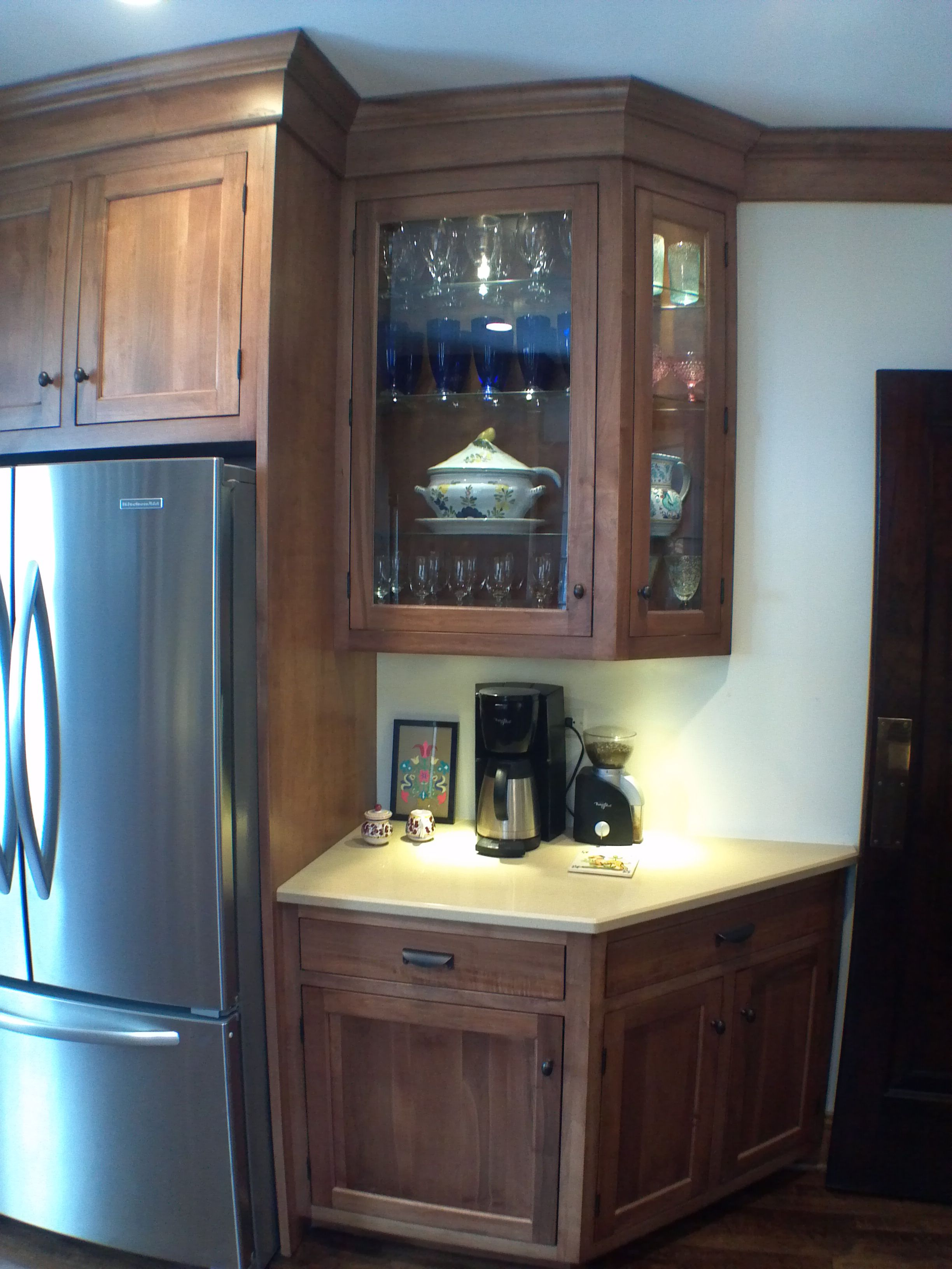 Dark stained inset kitchen cabinet with glass doors ...