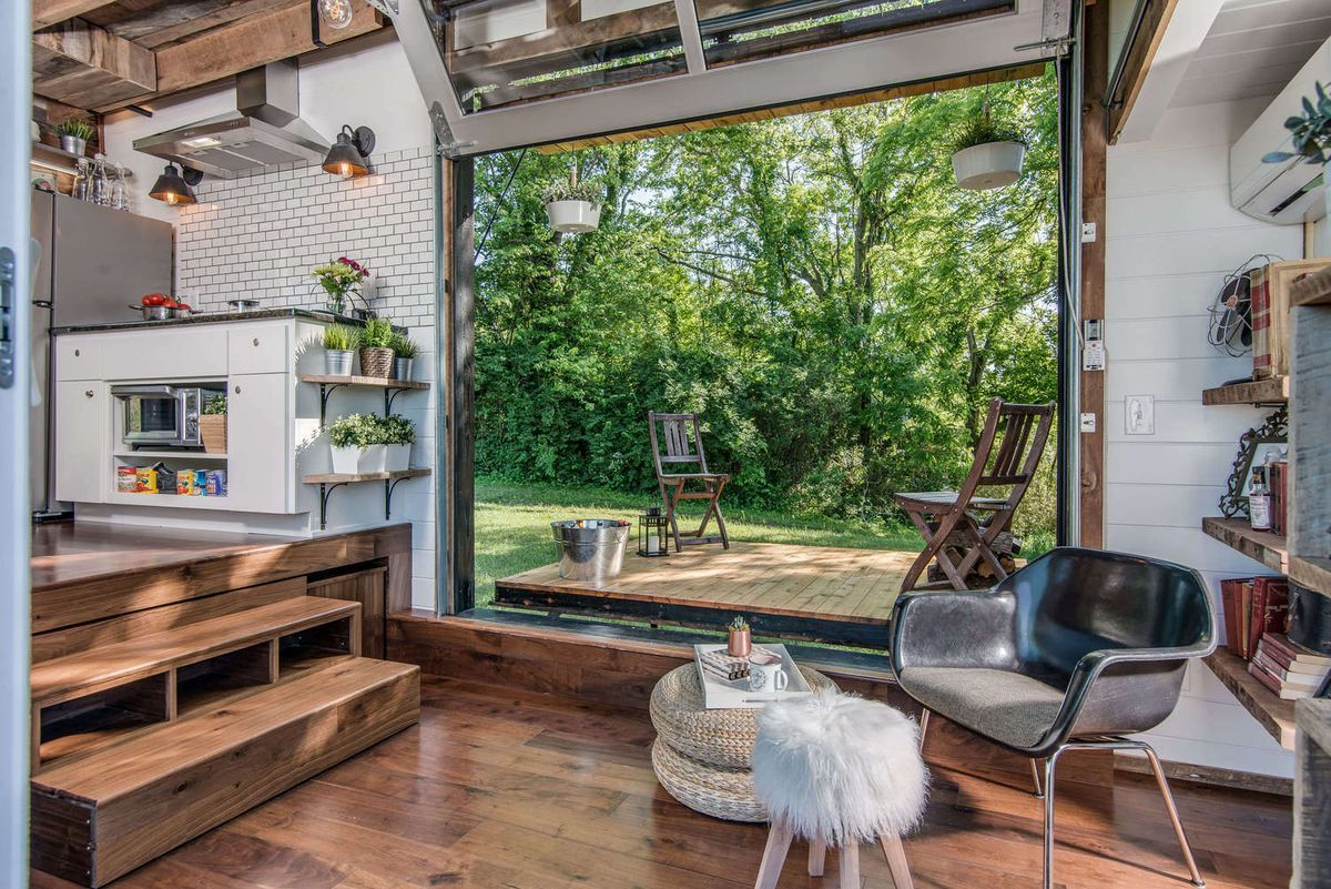 Tricked Out Tiny Home Features Garage Door And Custom Deck Best Tiny House Tiny Luxury Tiny House Luxury