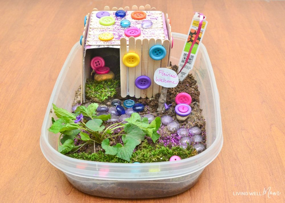 How to make a fun DIY fairy house for kids - encourage imaginative play with this fun craft idea, plus use up miscellaneous craft and recycled materials around the house! #kidsactivities #kidscrafts #imagine #craftsforkids #fairyhouse #fairy #fairygarden #kids