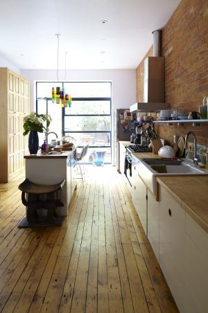 Floors/exposed brick in kitchen