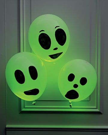 Insert glow stick into white balloon and add face with black marker.  Fill your windows with these on Halloween!