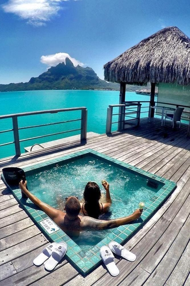 best honeymoon resorts the st regis bora bora resort couple -in-privat-pool