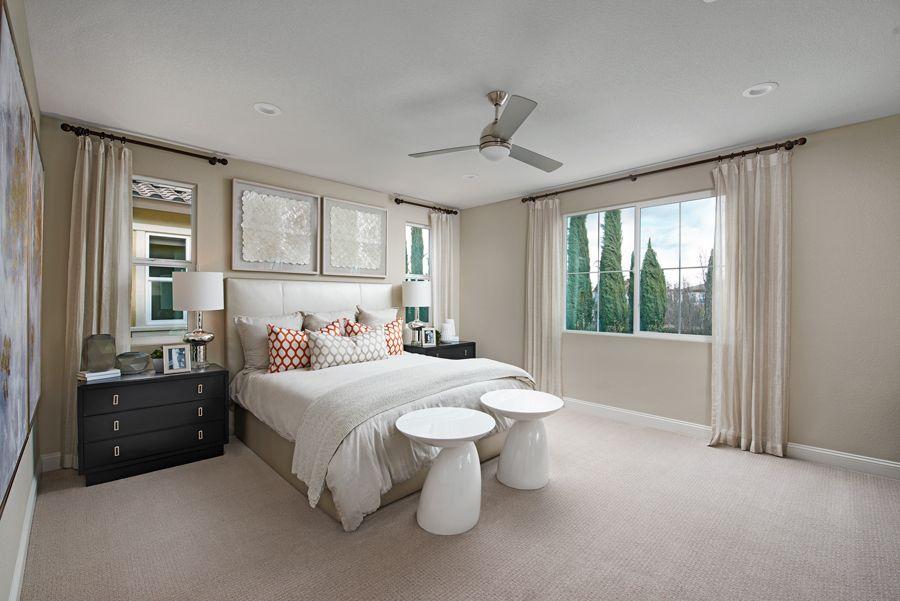 Statement shapes Stacey model home master bedroom