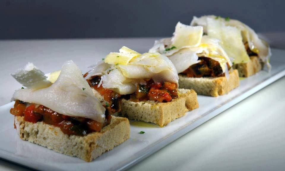 Tosta de bacalao con pisto. Tosta cod with ratatouille Velouté, Pinchos y Tapas Av. de la Buhaira 23, local 8, 41018 Seville, Spain 954 04 79 79