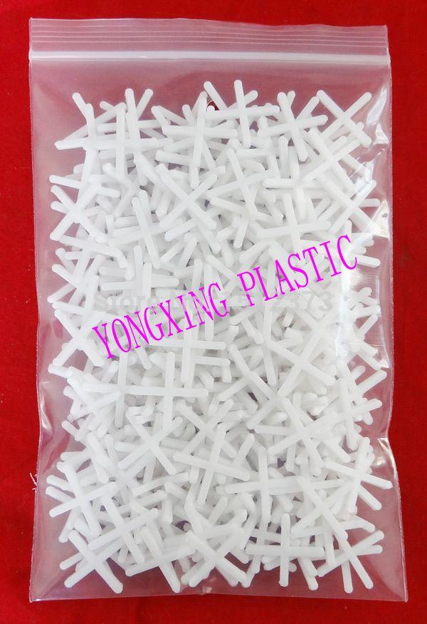 250pcs/bag plastic cross/ tice spacer 1.5 white color