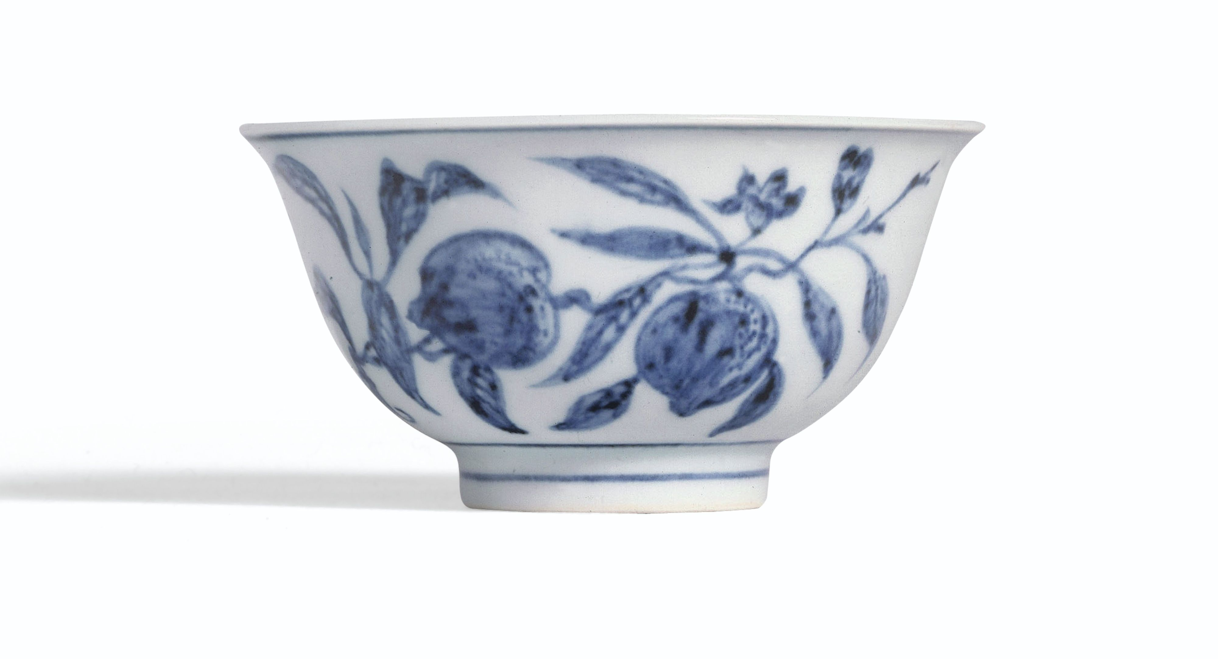 A RARE BLUE AND WHITE 'PEACH' CUP  MING DYNASTY, YONGLE PERIOD.