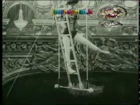 ACROBATICS: Acrobat from 1910-1920. Appears to be a vaudeville act rather than a circus routine.  3:55  ▶️
