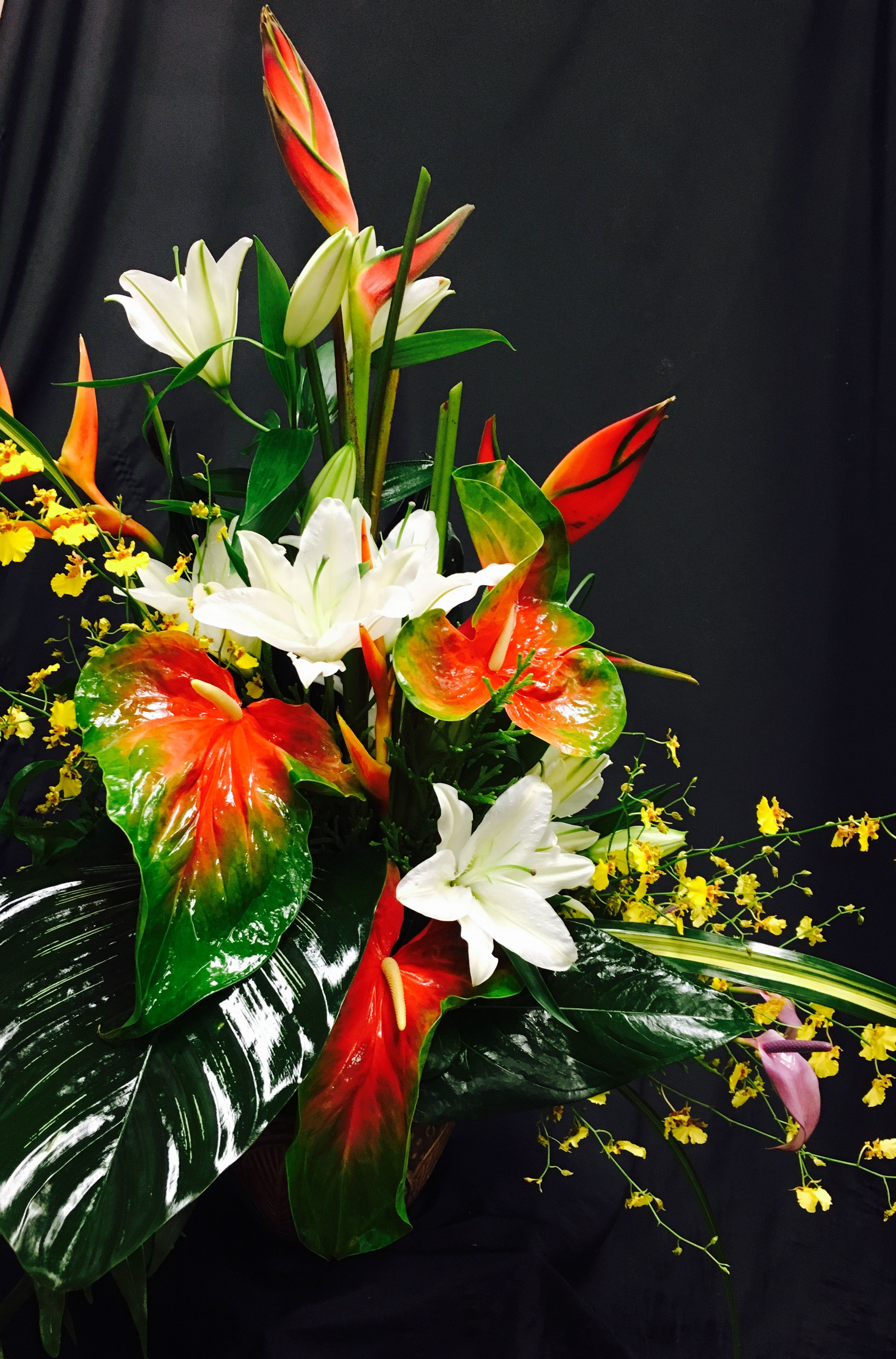 This flower bouquet of exotic flowers like red ginger is a tropical ...