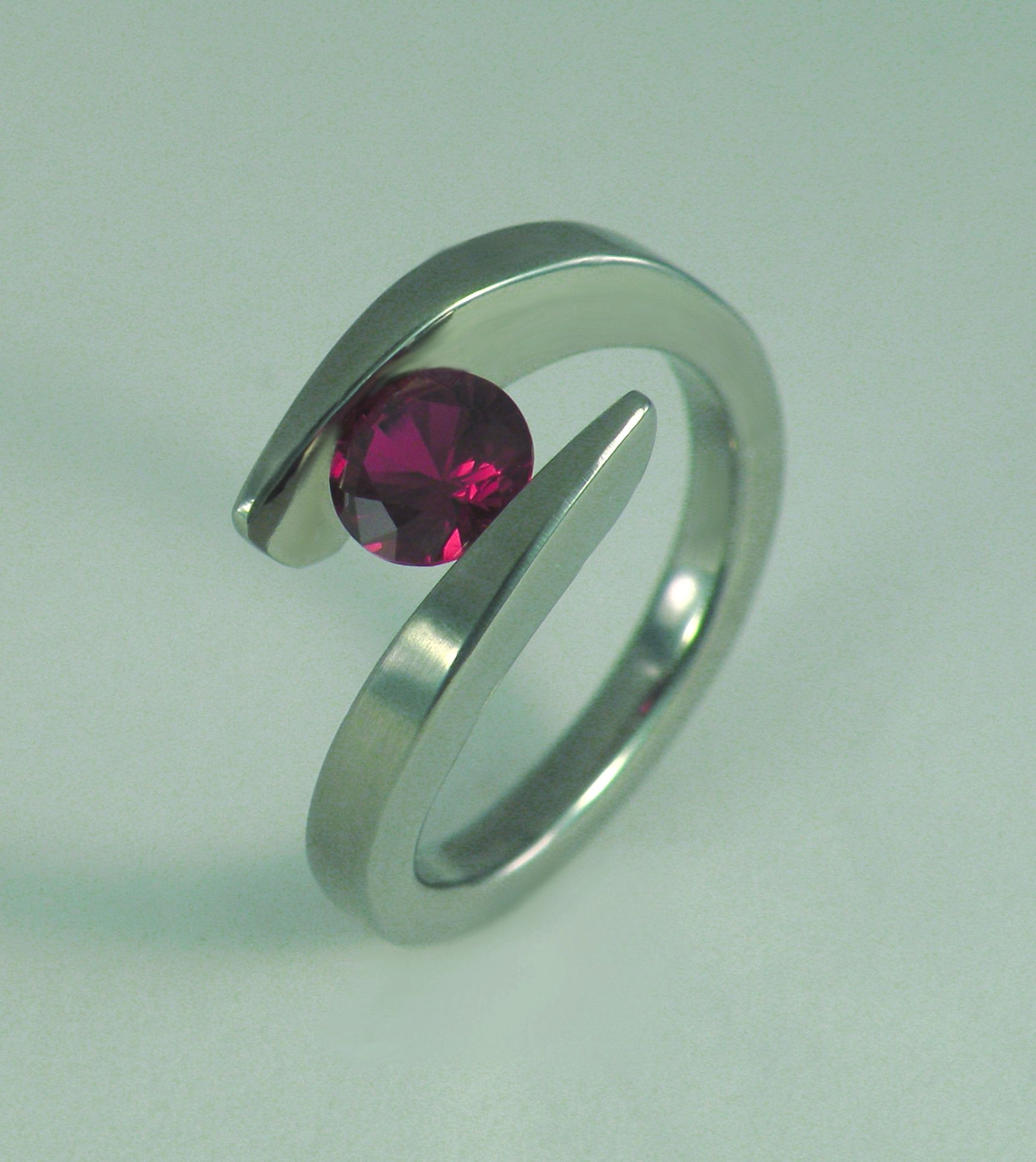 f you believe that the ruby should be the focus of your ring, then this is the ring for you. The Pointed Twist of Fate ruby Ring is one of the newest variations of my very popular design, The Twist of Fate Ring. The ring coils around the finger, overlapping in the front, and securely [...]