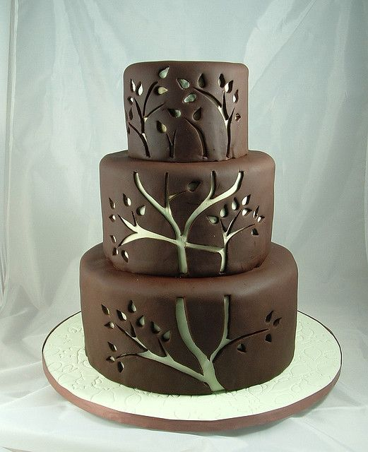 I like the cut-out look-but wow, that's a lot of fondant or modeling chocolate.