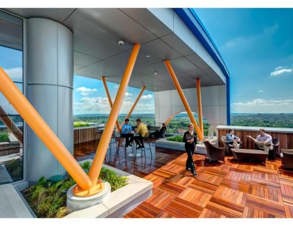 The 14th floor meeting rooms and the staff stairs connect to the roof deck, which features covered seating spaces and panoramic views of the city. Photo by Joe Harrison, JH Photography Inc.