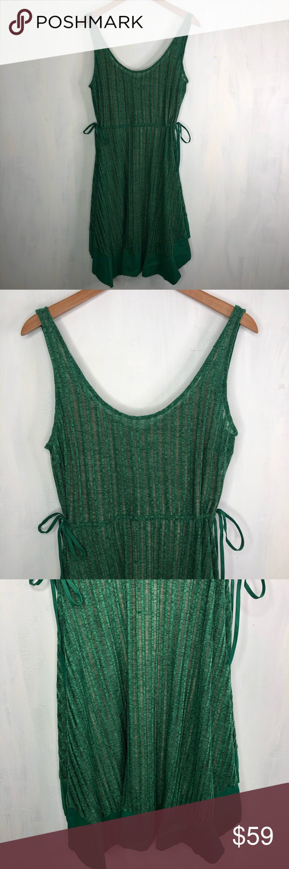 """Tracy Reese x Anthropologie Lino Swing Dress M Tracy Reese x Anthropologie Lino Swing Dress M. Condition: . Color: green. Size: m medium. Measurements are approximate; taken while garment is lying flat: 19"""" across chest, 13"""" across waist, 39"""" length (at longer points) Additional features: ties at waist, fully lined, flutter asymmetrical handkerchief hem. Offers welcomed, trade requests are not. Inventory #0137 Anthropologie Dresses"""