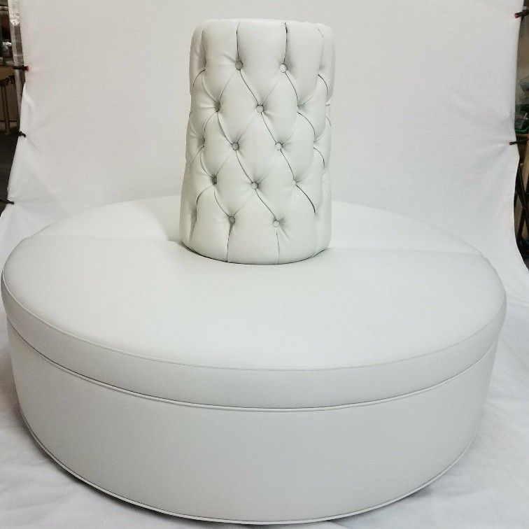 Photo Session For A White Round Circle Settee Sofa Made By Celebrity Furnishings In Faux Leather Tufting On The Cone